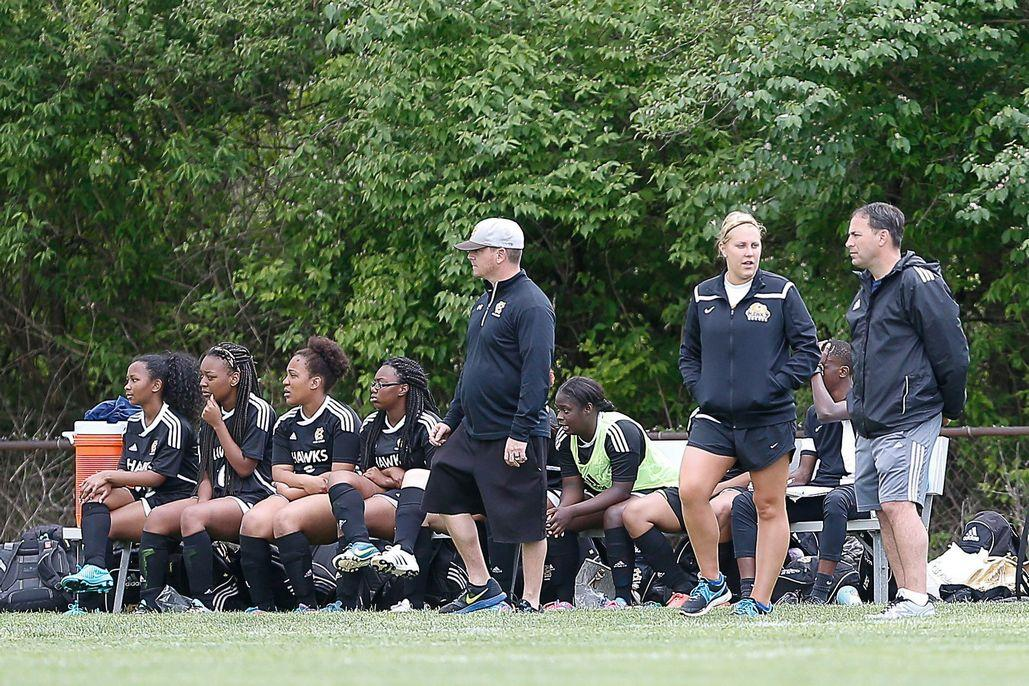 Coach Pat Rocco watches from the sideline as the varsity girls team battles Hazelwood East.