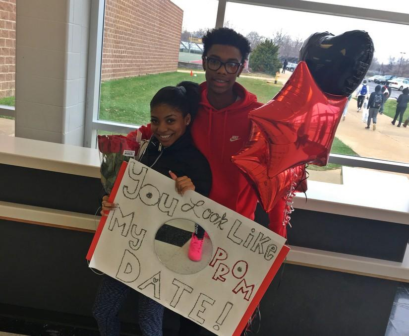 Junior+Camille+McNeal+with+her+boyfriend+Antonio+Tatum+and+the+promposal+sign+he+used+to+ask+her+to+the+McCluer+prom+on+March+16th.++%22I+didn%27t+know+it+was+for+me+at+first.+I+felt+special%2C%22+she+said.