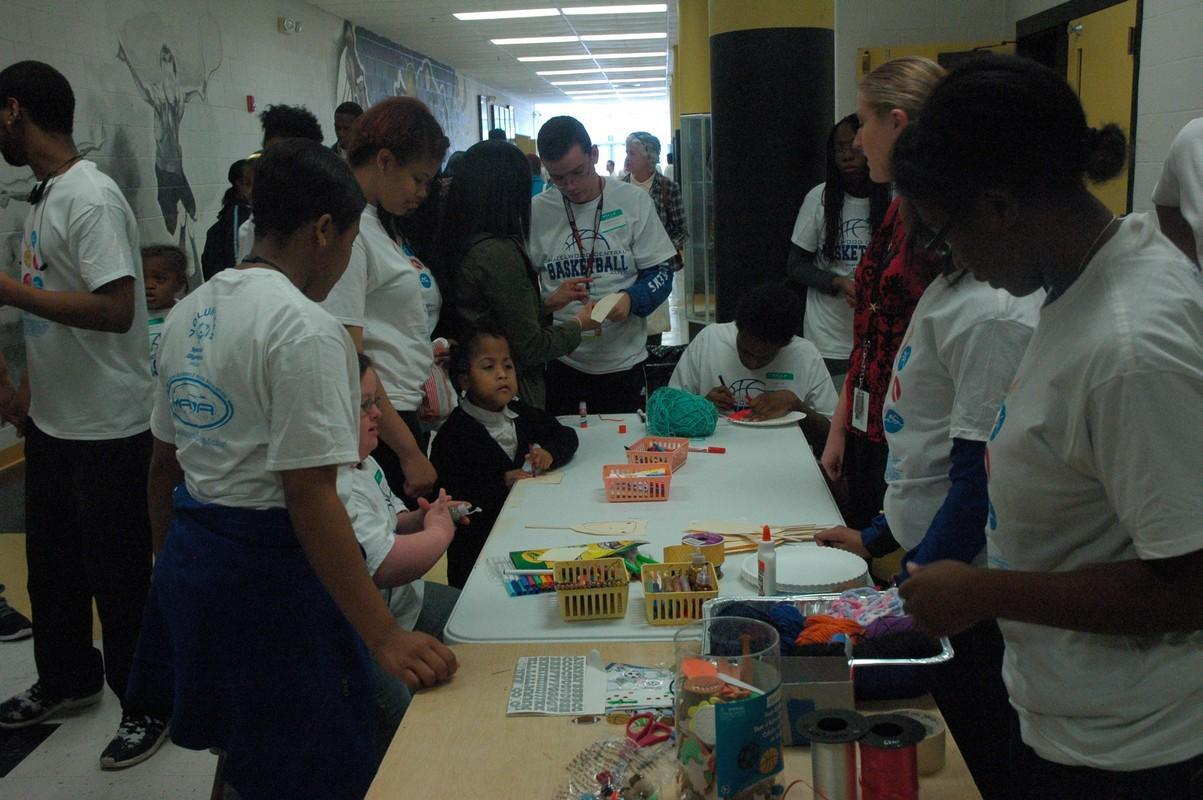 Buddies and participants enjoy a craft at last year's Special Olympics event. On March 7th, Central will once again host basketball and other games for area special needs students.