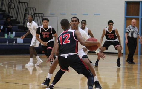 Senior Shaun Williams (center) is just one of many talented players returning to the varsity basketball team this year, leading to high expectations for success.