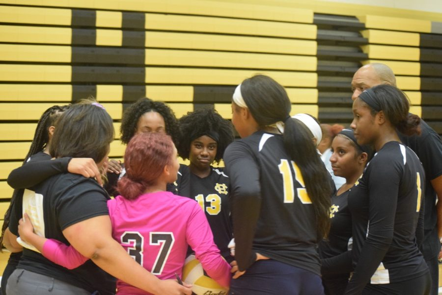 Members+of+the+volleyball+team+huddle+during+the+senior+night+game.+