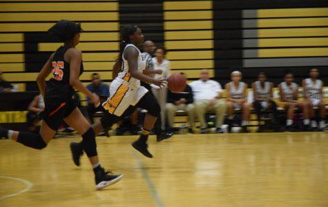Senior Kelsie Williams makes a break for the basket.