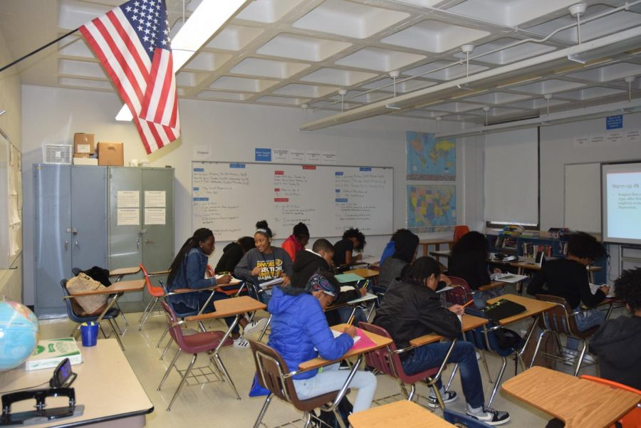 Students start their warm-up in Mr. Johnson's freshman Government class.