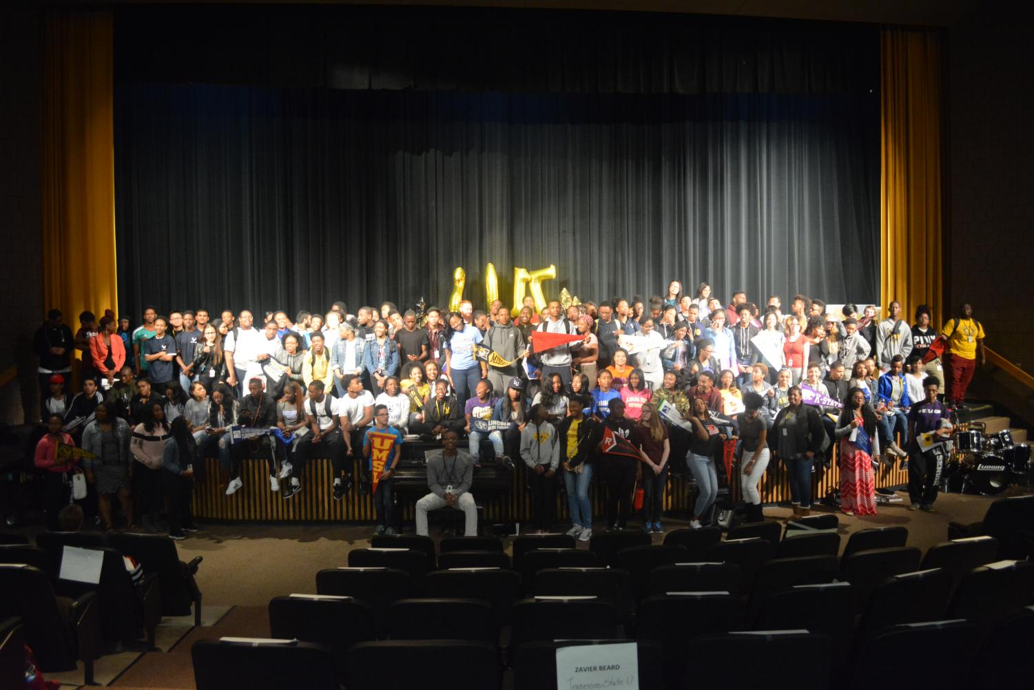 Seniors pose at the 2017 college celebration. Students often choose a school based on the type of scholarships offered to them.