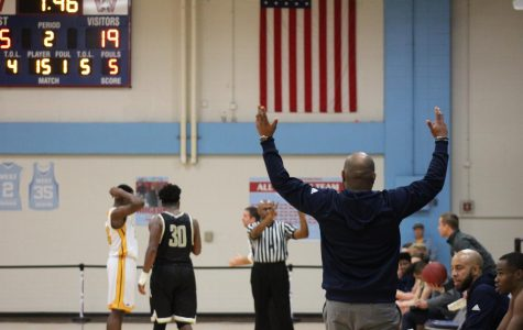 Coach Gilmore shows his displeasure at a call against the Hawks during the Ameritime Tournament. The Hawks would go on to win first place.
