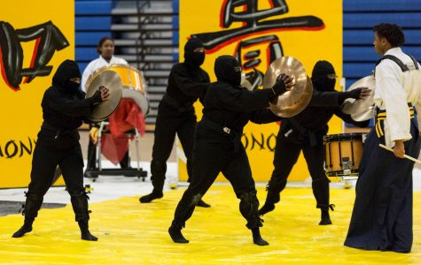 Members of the drumline perform at Francis Howell High School.