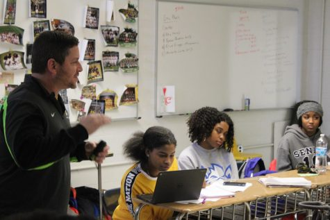 "Mr. Rocco works with his AP Psychology class. Like many all other classes, students need to make sure they keep up with their assignments give themselves the best chance to succeed. ""The work is hard but manageable so stay on top of everything,"" said Aiyana Young."