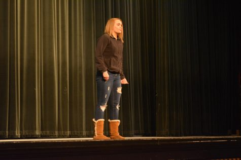 "Sophomore Samantha Beeman recites a poem, ""I find no peace"" by Thomas Wyatt during the Poetry Out Loud competition in the auditorium on January 24th."