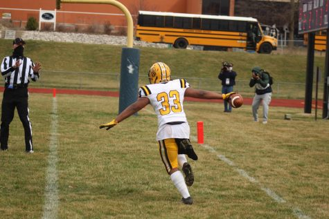 Matt Logan celebrates a touchdown in the Hawks win in their opening game of the season versus McCluer North.